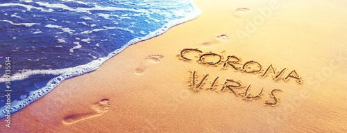 Fototapeta Corona virus written in the sand on vacation obraz