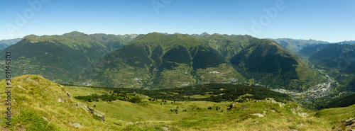 Panorama of the mountains. View of mountain range in the Aran valley with green trees from Montcorbison peak