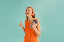 Happy Female Listening To Music