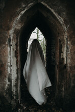 Ghost Moving In Arch Of Abandoned Building