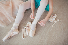 Young Ballerina Getting Ready