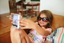 Little Girl Takes Selfie In Su...