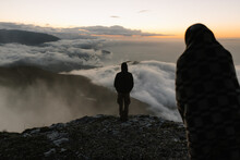 Couple Stands On The Edge Of C...