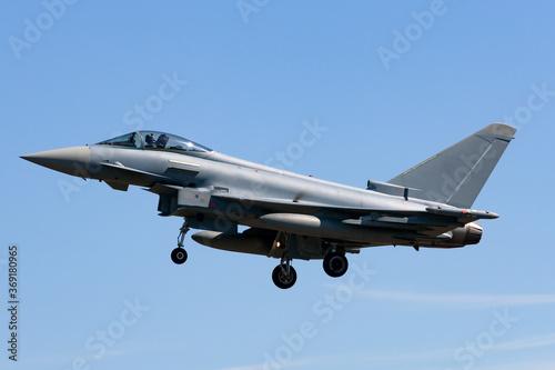 Photo Advanced combat aircraft prepping to land at an air base.