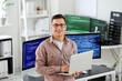 Leinwandbild Motiv Portrait of male programmer in office