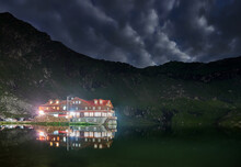 Chalet In The Mountains At Night