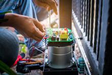 A Technician Assembling Motor ...