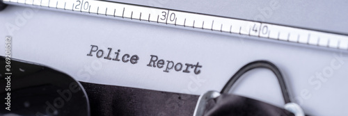 Obraz Police Report written with a vintage typewriter. Panoramic image - fototapety do salonu