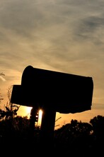 Sunset Out In The Country With A Colorful Sky And Mailbox Silhouette In Kansas.
