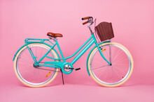 Photo Of Woman Retro Vintage Bicycle Used For Town Transportation With Brown Basked Isolated Over Pink Color Background