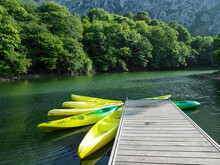 Canoes On A Lake With A Beauti...