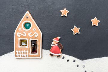 Weihnachtsmotiv mit Lebkuchen auf schwarzem Hintergrund