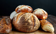Various of baked bread on wooden table background