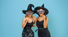 Two Young Women In Black Witch...