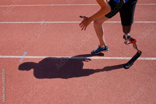 Close up of sportsman with prosthetic foot running Fotobehang