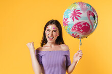 Image Of Excited Woman Holding...