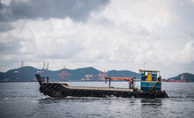 Small Container Boat Sails To Pick Up The Goods From The Big Ship, Si Racha District, Chon Buri Province, Thailand