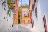Fototapeta Na drzwi - Traditional cozy greek street in city Nafplio, Greece