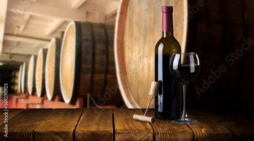 Fotografie, Tablou Row of vintage wine bottles in a wine cellar shallow