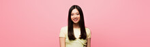 Horizontal Image Of Positive Young Asian Woman Looking At Camera And Smiling Isolated On Pink