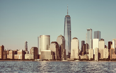 Fototapeta Vintage Manhattan skyline with cloudless sky at sunset, color toning applied, New York City, USA.