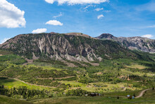 Rugged Landscape Of Mountains, Green Fields, Ranches, And Buildings Along Last Dollar Road Near Telluride, Colorado
