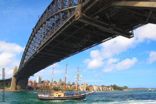 Sydney Harbour Bridge with City Skyline and a beatuiful boat sail ,under,  Sydney, New South Walls, Australia © Sabrina