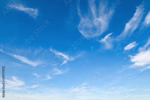 white cloudy with blue sky background
