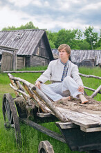 Country Boy Sitting In An Old Cart