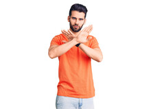Young Handsome Man With Beard Wearing Casual T-shirt Rejection Expression Crossing Arms Doing Negative Sign, Angry Face