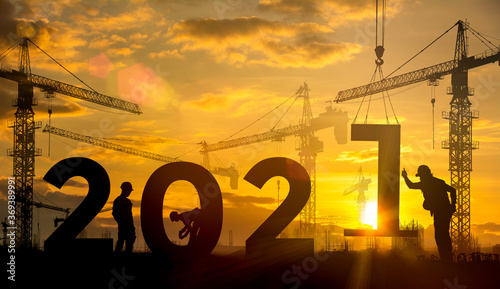 Fotomural Silhouette construction site,Cranes building construction 2021 year sign
