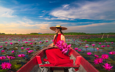 Fototapeta Orientalny Outdoor traveler woman on boat joy beautiful nature scenic landscape red lotus flower blooming on lake, Tourist girl travel Phatthalung Thailand summer holiday vacation trips, Tourism destination Asia