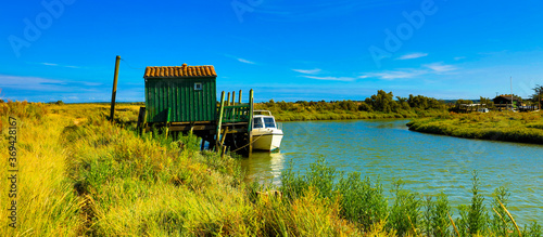 Obraz na plátně fishing hut and canal- beautiful france landscape- Charente Maritime