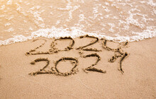 Change Year 2020 To 2021 On Sand Beach. Ocean Wave And Lettering On The Beach. Happy New Year 2021. Tropical Vacation