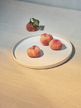 Close Up Of Peaches On Plate