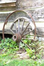 Old Wagon Wheel Against A Log ...