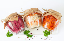 Homemade Marinated Canned Vegetables. Three Glass Jars Of Delicious Fermented Food