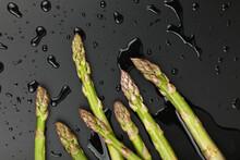 Fresh Green Washed Asparagus On Black
