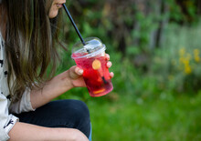 Young Woman Drinking A Red Cocktail