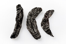 Dried Mexican Black Hot Chile Pasilla Chili Offered As Close-up On White Background With Copy Space - Free-form Select