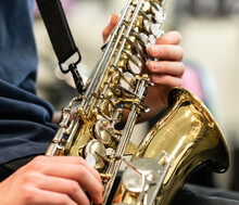 Midsection Of Boy Playing Saxophone In Music Class