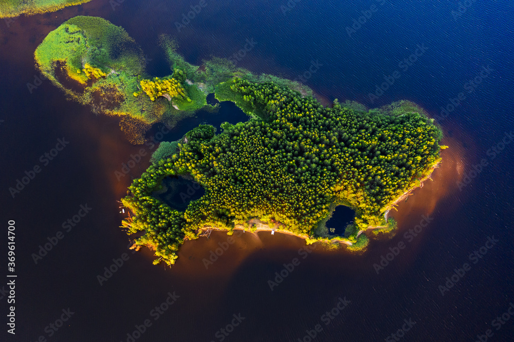 Aerial view of the green island on the river of Kama in Russia