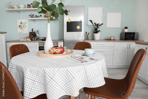 Dining table in interior of modern kitchen Fototapeta