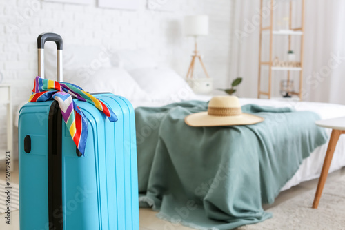 Obraz Packed suitcase at home. Travel concept - fototapety do salonu