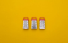 Mini Graters On Yellow Background. Top View