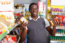 Cheerful African Man Holding C...