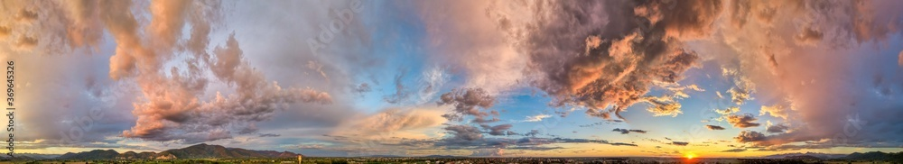 Fototapeta Amazing panoramic aerial view of sunset sky. Beautiful clouds and colors at dusk