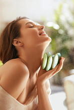 Woman With Aloe Vera. Happy Model Holding Fresh Juicy Slices Of Leaf. Organic Cosmetic For Hydrated Skin. Young Tender Brunette With Naked Shoulder Posing With Closed Eyes.