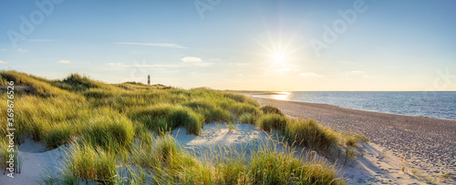 Dune beach with lighthouse on the island of Sylt, Schleswig-Holstein, Germany  - 369676526