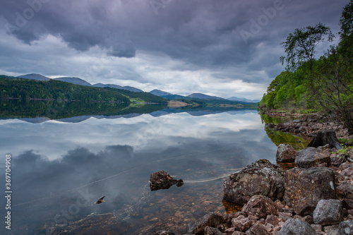 Obraz na plátně Looking West over Loch Garry with reflections of moody skies.